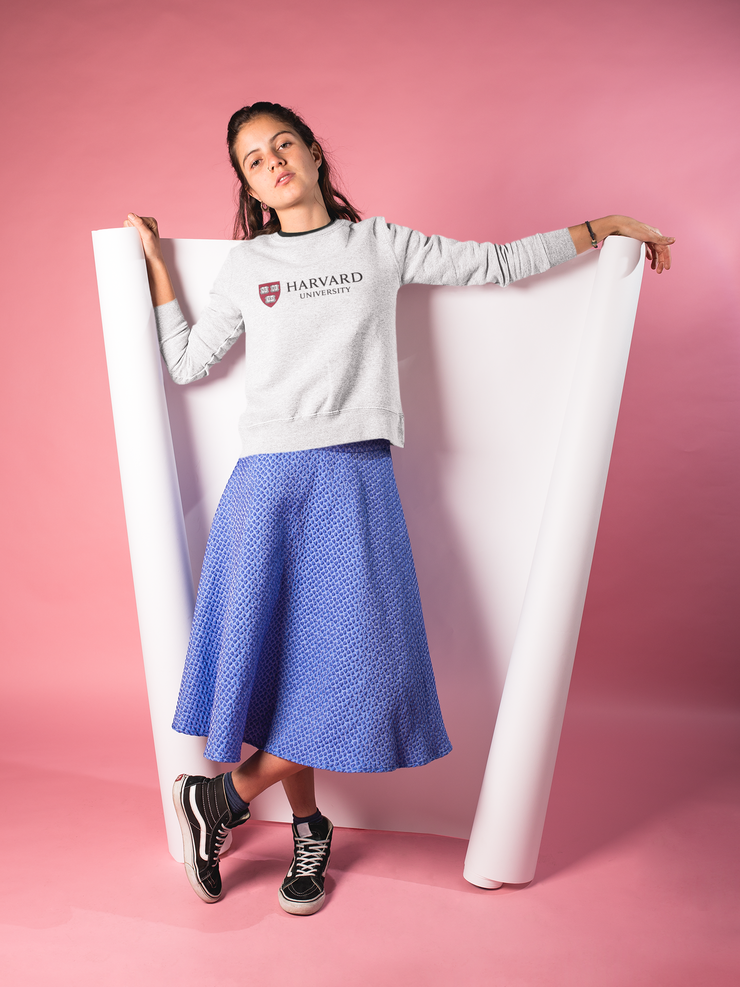 Left-Eye-Creations-girl-wearing-a-Screen-Printed-crewneck-sweatshirt-mockup-lying-over-a-cyclorama-in-a-pink-room-a18506.png