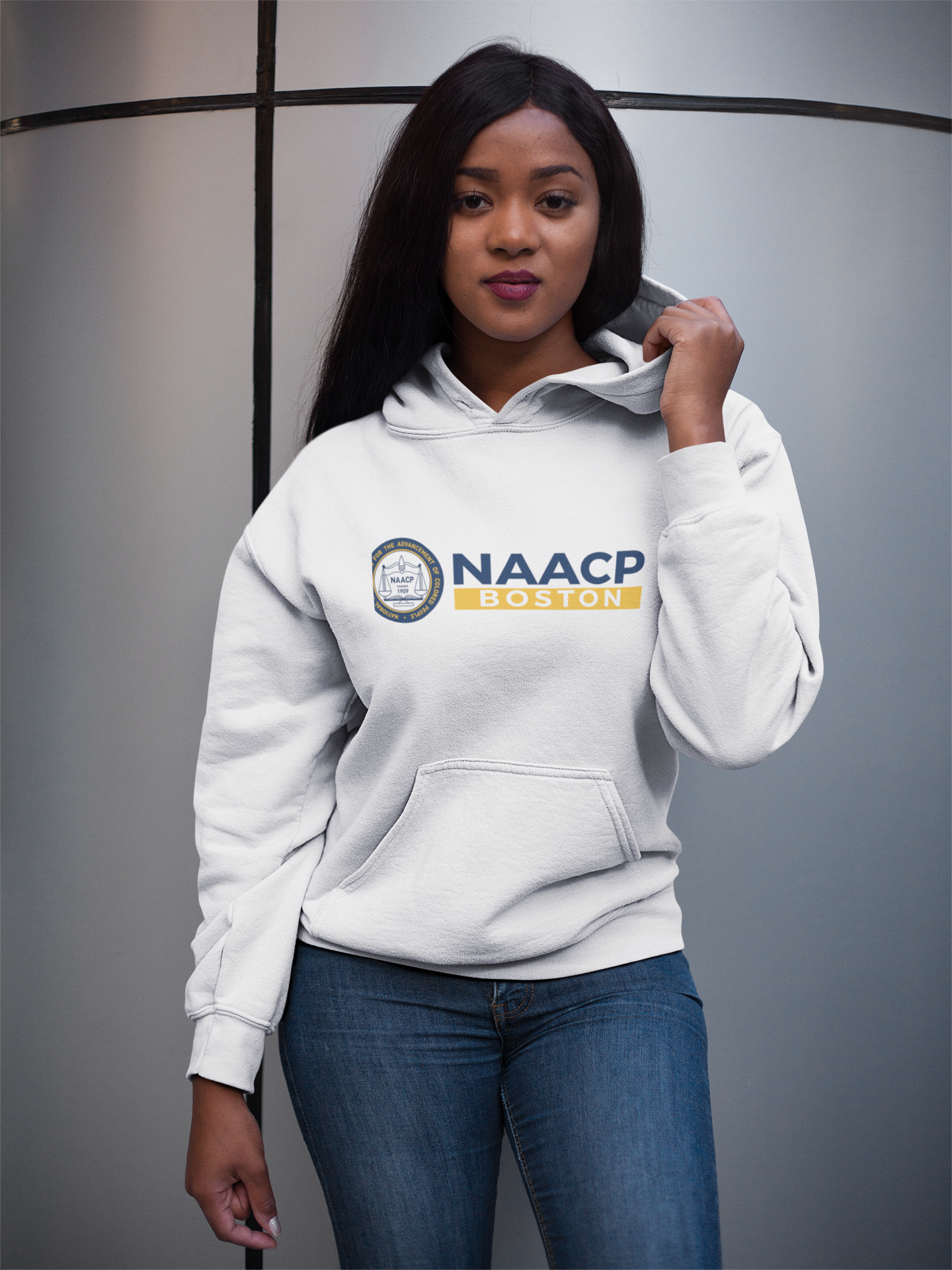 Left-Eye-Creations-NAACP-Boston-girl-holding-her-Printed-hoodie.png